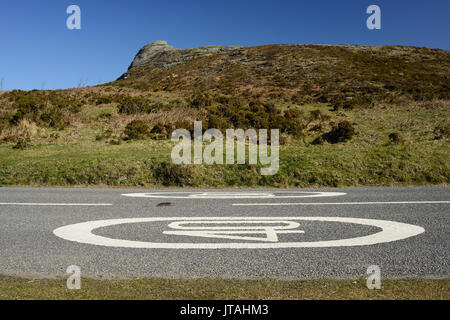 Elongated speed limit sign on a road across Dartmoor. - Stock Photo