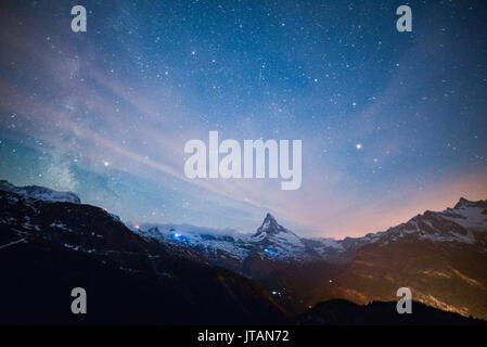 Starry night in Alps, Matterhorn Peak, Zermatt, Switzerland - Stock Photo