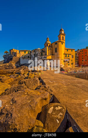 Italy Liguria Camogli - the church of St. Maria Assunta and the beach at the first lights of the sun - Stock Photo