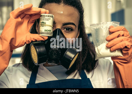 young girl laboratory technician in personal protective equipment, chemical lab - Stock Photo