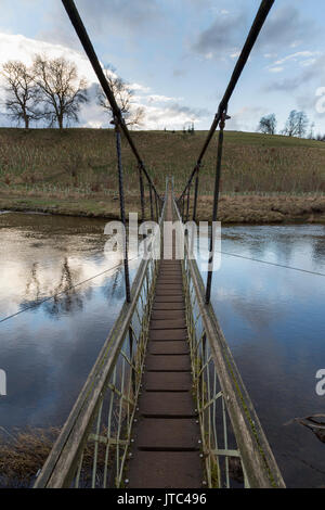 Footbridge over the river Wharfe near Grassington in the Yorkshire Dales National Park - Stock Photo