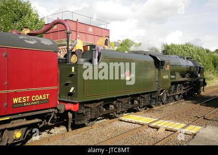 LMS Royal Scot class 7P steam locomotive Scots Guardsman taking on water at Appleby station, UK with 'The Dalesman' - Stock Photo