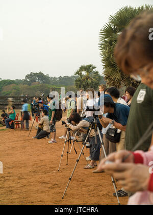 Crowd of photographers lined up for dawn shoot at Ankgor Wat temple, Siam Reap, Cambodia - Stock Photo