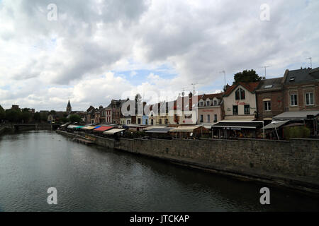 View of Somme River and restaurants on Quai Belu from Boulevard du Cange, Amiens, Somme, Hauts de France, France - Stock Photo
