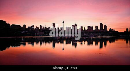Sydney CBD sunrise, Australia Vivid Sydney CBD sunrise with clear water reflections. Photographed from, on the water, at Blackwattle Bay.  Sydney, Aus