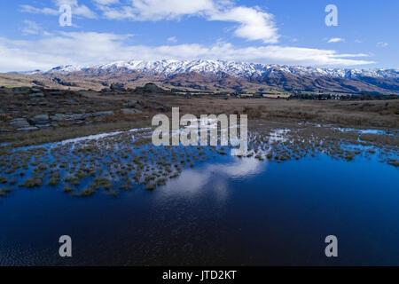 Sutton Salt Lake, and Rock and Pillar Range, Sutton, near Middlemarch, Strath Taieri, Otago, South Island, New Zealand - Stock Photo