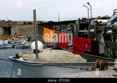 Lavrio Port Attica Greece washing hanging on line to dry on fishing boat - Stock Photo