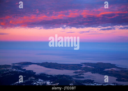 Otago Peninsula and Otago Harbour at sunset, Dunedin, South Island, New Zealand - aerial - Stock Photo