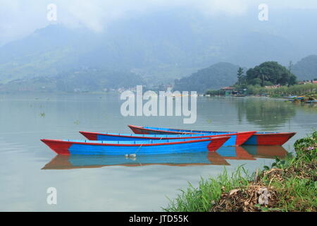 Pokhara / Nepal – September, 2015: colorful wooden boats at Phewa Lake, one of the Major tourist attractions of - Stock Photo