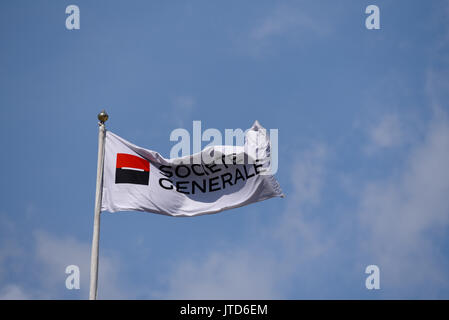 Societe Generale flag flying above the banking business building in Tower Hill, London. Space for copy. Blue sky - Stock Photo