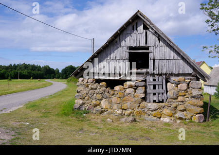 Old barn in island Kihnu. Estonia 5th August 2017 - Stock Photo