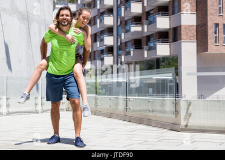 Attractive young couple train in the urban environment - Stock Photo