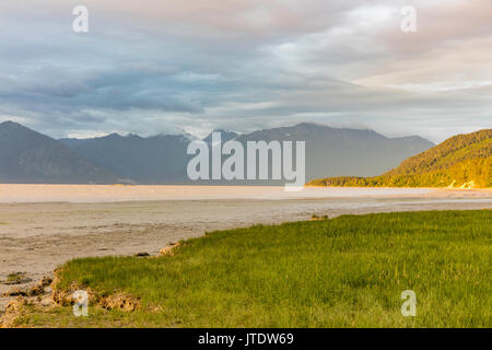 Warm and cool evening light enhance this scenic view of the Chugach Mountains and Turnagain Arm from Hope in Southcentral - Stock Photo