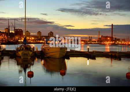 Sunset in Helsinki. Ships and yachts sleep in harbor - Stock Photo