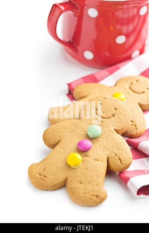 Two gingerbread men isolated on white background. Xmas gingerbread. - Stock Photo