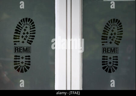 Window of the REM bar on Canal Street in Manchesters Gay Village - Stock Photo