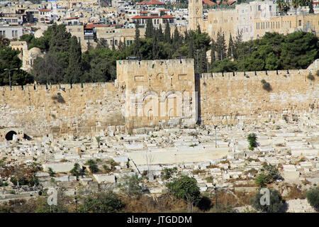 The Eastern or Golden Gate and cemetery as seen from the Mount of Olives in Israel.  Also known as the Gate of Mercy - Stock Photo