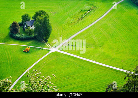 Aerial view on cultivated land divided by the crossing lanes. View from the Hohensalzburg castle, Salzburg, Austria - Stock Photo