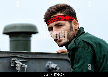 Primorsky Territory, Russia. 9th Aug, 2017. An Iranian Navy marine competes in the relay race stage of the Seaborne - Stock Photo