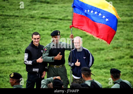 Primorsky Territory, Russia. 9th Aug, 2017. A marine (C) of the Venezuelan National Bolivarian Armed Forces poses - Stock Photo