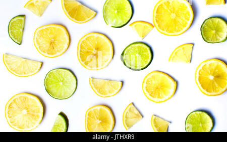 Lemon and lime slices on white background - Stock Photo