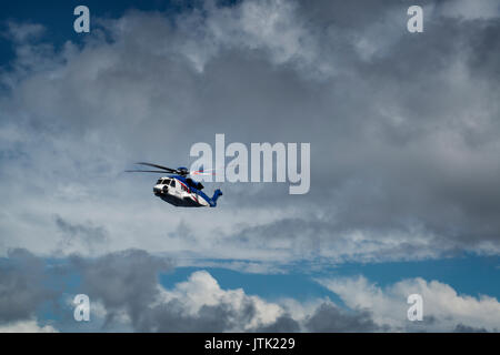 A north sea Bristow helicopter - Sikorsky S92 in flight to an oil and gas platform. credit: LEE RAMSDEN / ALAMY - Stock Photo