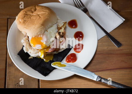 English breakfast in a bread roll - Stock Photo