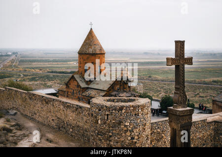 Cross is in front of Khor Virap temple, Armenia - Stock Photo