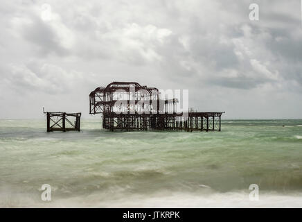 Brighton beach and the remains off the West pier long exposure East Sussex - Stock Photo