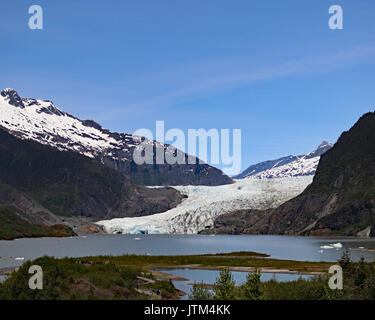 Mendenhall Glacier used to be called Sitaantaggo 'The glacier behind the town' and also Aak'wtaaksit 'The glacier - Stock Photo