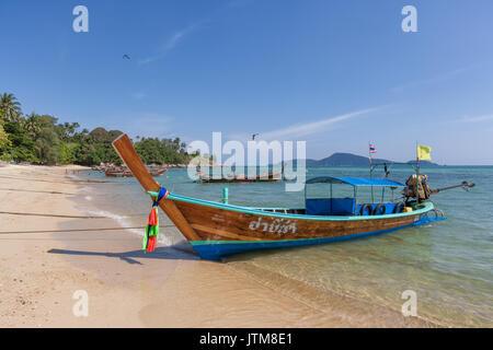 Traditional longtail fishing boats moored at Rawai Beach, Phuket, Thailand - Stock Photo