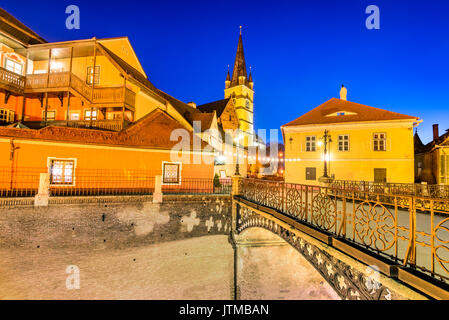 Sibiu, Romania. Evangelical Cathedral and the Liars Bridge in the center of Sibiu, Transylvania, European Capital - Stock Photo