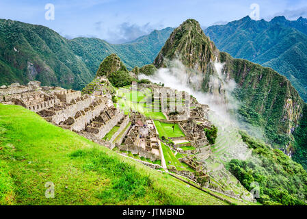 Machu Picchu, Peru - Ruins of Inca Empire city and Huaynapicchu Mountain, Sacred Valley, Cusco. Amazing place of - Stock Photo