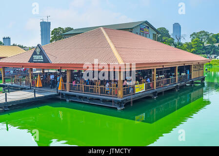 COLOMBO, SRI LANKA - DECEMBER 7, 2016: The crowded restaurant on the platform on Beira lake next to the Pettah Floating - Stock Photo
