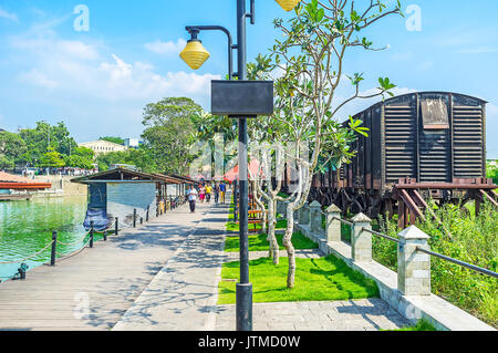 COLOMBO, SRI LANKA - DECEMBER 7, 2016:  The freight train from the Fort Railway station next to the Pettah Floating - Stock Photo
