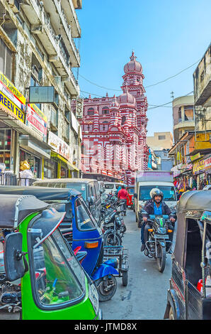 COLOMBO, SRI LANKA - DECEMBER 7, 2016: The heavy traffic in the narrow street of Pettah market with the scenic building - Stock Photo