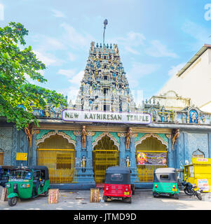 COLOMBO, SRI LANKA - DECEMBER 7, 2016: The facade of New Kathiresan Temple in Pettah district with many tuk tuks - Stock Photo