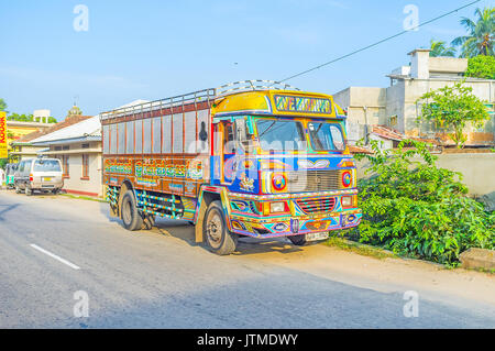 NEGOMBO, SRI LANKA - DECEMBER 7, 2016: The bright painted  truck is parked by the road in residential neighborhood, - Stock Photo