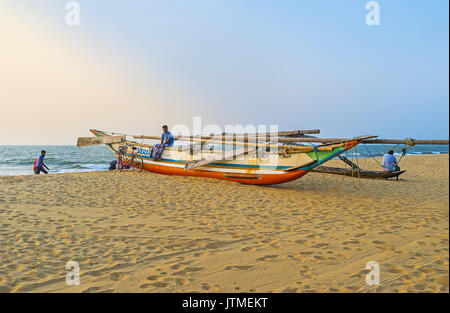 NEGOMBO, SRI LANKA - DECEMBER 7, 2016: The fishing Oruwa canoe on the sand of the beach, on December 7 in Negombo, - Stock Photo