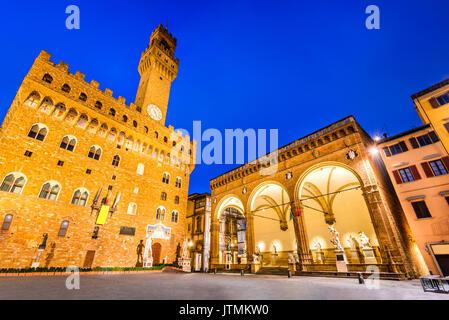 Florence, Italy. Palazzo Vecchio (or Palazzo della Signoria ) and Loggia dei Lanzi, twilight scene in Tuscany. - Stock Photo