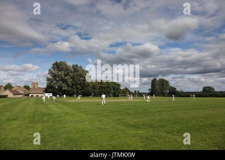Village cricket match in cotswolds - Stock Photo