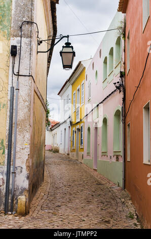 Small cobbled street with colourful buildings in Silves, Algarve, Portugal - Stock Photo