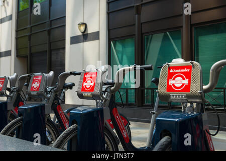 UK London City Aldgate St Mary Axe Santander bikes cycles bicycles hire rental park station detail signage logo - Stock Photo