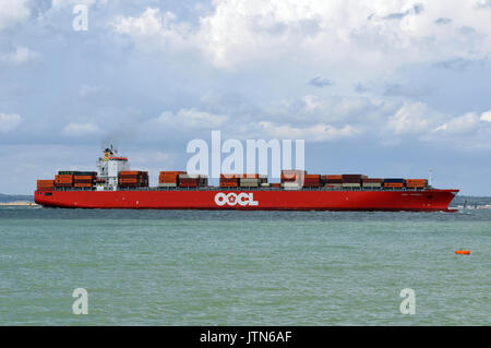 a very large container ship or vessel entering or leaving the port of Southampton docks carrying a cargo of boxes - Stock Photo