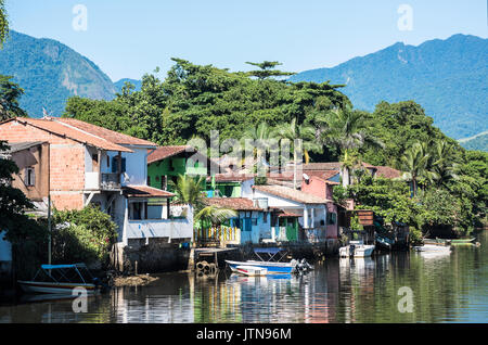 Paraty, Brazil - February 24, 2017: View of the canal and the colonial houses of the historic town Paraty, Rio de - Stock Photo