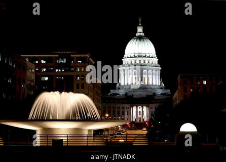 National Historic Landmark. Madison, Wisconsin, USA. Night scene with official buildings and illuminated fountain - Stock Photo