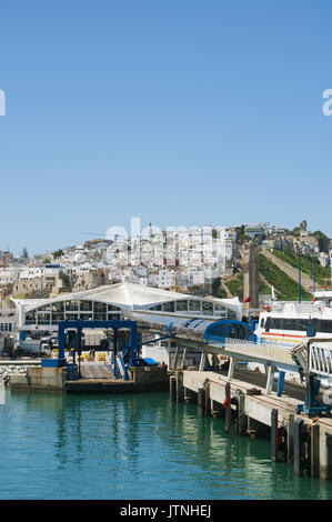 Port and skyline of Tangier, city on the Maghreb coast at the western entrance to the Strait of Gibraltar, where - Stock Photo