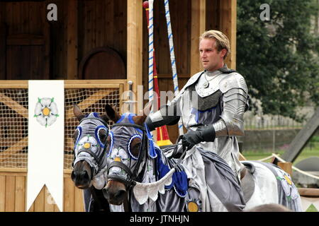 Jousting tournament and medieval re-enactment of the Wars of the Roses at Warwick Castle - Stock Photo