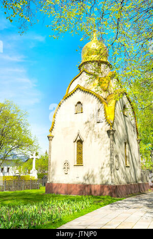 The small golden domed Prokhorov Chapel located in beautiful garden on territory of Novodevichy Convent in moscow, - Stock Photo