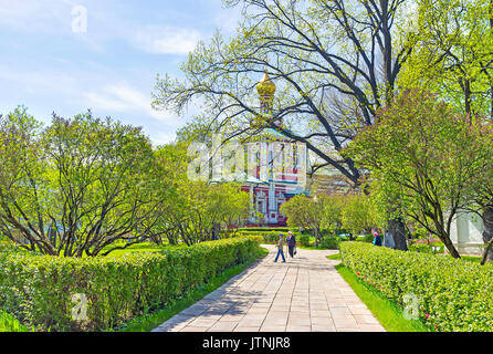 MOSCOW, RUSSIA - MAY 8, 2015:  Novodevichy Convent boasts numerous shady alleys with trimmed bushes, on May 8 in - Stock Photo